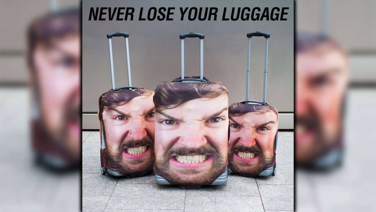 Now You Can . . . and Should . . . Buy a Luggage Cover That's a Giant Picture of Your Face