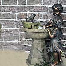 Boy & Girl at Fountain Water Feature