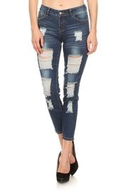 All Over Distressed Denim Skinny Jeans