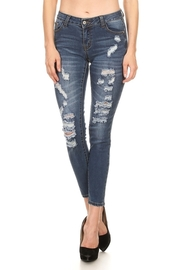 All Over Ripped Off Skinny Jeans