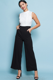 SLEEVELESS TOP AND LOOSE FIT JUMPSUITS