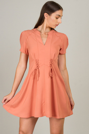 A Line Dress With Crisscross Accent At The Waist