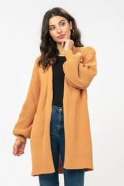 Balloon sleeve cardigan with a ribbed knit border along hemline and sleeves.
