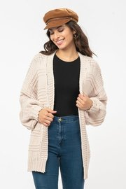 A cunky knit, open front cardigan with balloon sleeves.