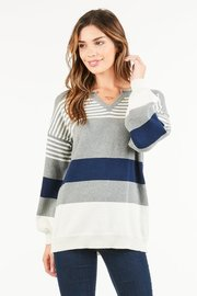 A boyfriend fit, striped pullover with an open ribbed neckline.