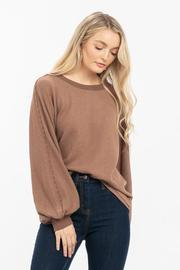 A waffle knit top featuring large dolman sleeves.
