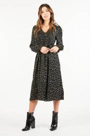 A spotted printed midi dress featuring a ruched chest panel and ruffle ruched sleeves.