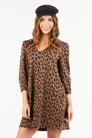 A soft, sweatshirt style swing dress featuring this season's hottest trend animal print.