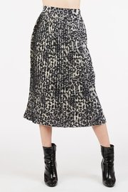 A pleated, animal print midi skirt with a hidden, back zipper closure.