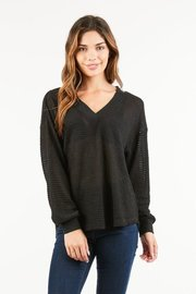 Waffle knit long sleeve top with a deep v shaped neckline.