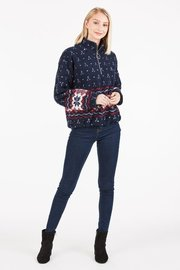 A three quarter zip, fleece pullover with a geometric print.