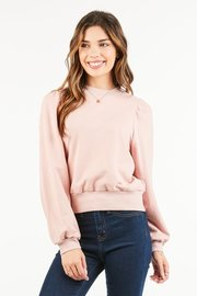 Semi cropped, loose fit pullover style top.