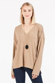 Loose fit V-neck long sleeve knit top.