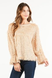 Shake and shimmer in this fringed pullover featuring mettalic sheen throughout.