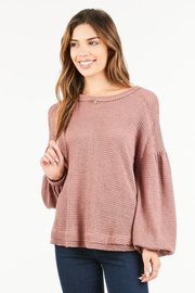 Scoopneck light weight waffle knit tee with distressed hemline and balloon sleeves.