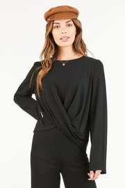 A scoopneck, ribbed top with a twist front detail creating a cropped length.