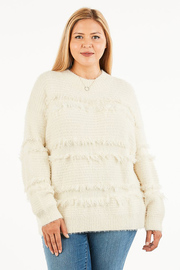 Plus Size Long sleeve knit sweater with fringe detail.