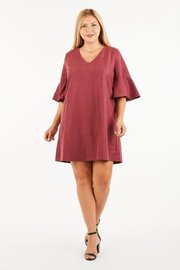 Plus Size A soft brushed woven tunic dress with flare sleeves.