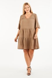 Plus Size A short sleeve ruffle layered smocked babydoll tunic.