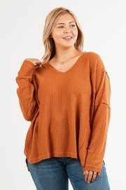 Plus Size a loose fit waffle knit long sleeve top.