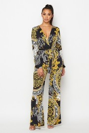 Long sleeved wide leg jumpsuit with self tie.