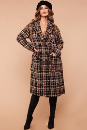 Couture inspired plaid tweed coat.