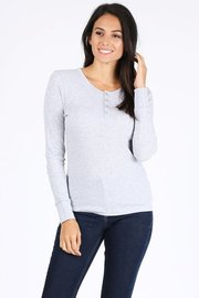 Basic solid henley neck long sleeve waffle knit thermal top.