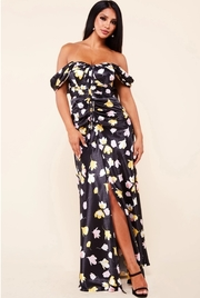 Floral print maxi features an off the shoulder neckline.
