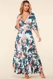 Tropical flamingo print maxi dress with a lace up back.