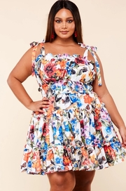 Plus Size Garden print mini dress with ruffle details smocking waist band and circle skirt.