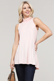 Turtle neck sleeveless tunic.