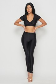 Nylon crop top and leggings set.