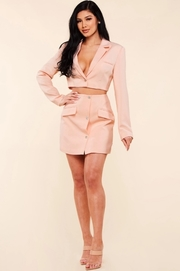 Pale pink two piece set includes a notch lapel cropped blazer