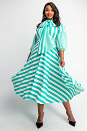Plus Size Puff sleeve tie neck dress.