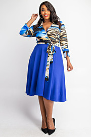 Plus Size 3/4 sleeve surplice top with flare skirt.