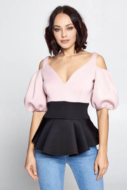 Two tone color peplum top.