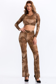 Snake print long sleeve crop top and flare leg pants set.