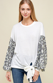 Long Sleeve top with leopard print on sleeve.