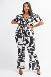 Plus Size Plated puff sleeve tie front top and flare pants set.