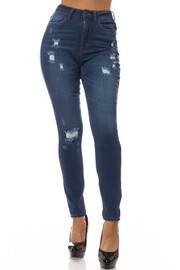 High Rise skinny jean with mild hand sanding & Destruction.