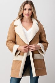 COWBOY SHEARLING COAT.