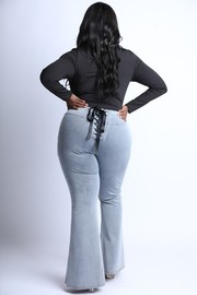 Plus Size Lace Up back detailed flare jeans.