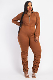 Plus Size French terry zip front jumpsuit with ruched bottom.