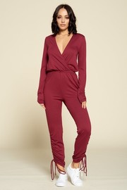Casual V-neck jumpsuit, long sleeves, ruched bottom hem with drawstrings.
