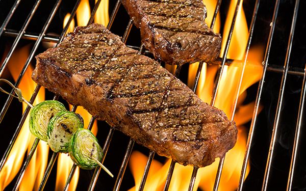 Strip Steaks on Grill
