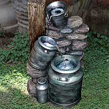 Milk Churns on Stone Wall Water Feature