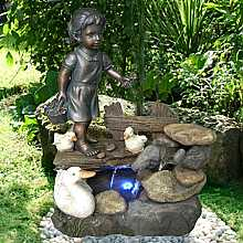 Girl Feeding Ducks Water Feature