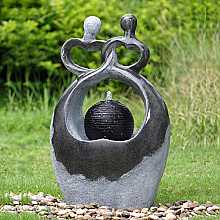 Couple with Bubbling Sphere Water Feature