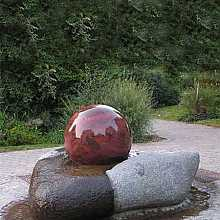 Rotating Granite Ball Water Feature on Natural Base
