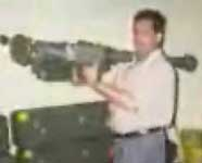 Rajaa Gulum Abbas holding a stinger missile, secretly recorded in a sting operation in August 1999. [Dateline NBC]